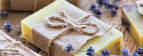 Lavender soap and salt on rustic wooden board. Spa concept